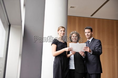 business people looking at paperwork