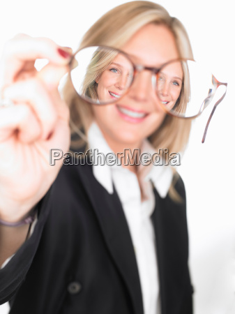 woman holding glasses in front of