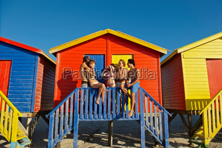 young people hanging out by beach