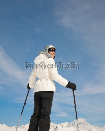 woman standing in mountain scenery