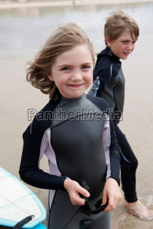 portrait of young surfer on beach