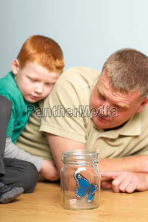 young boy with dad looking a