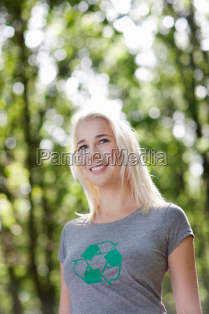 young woman standing in nature