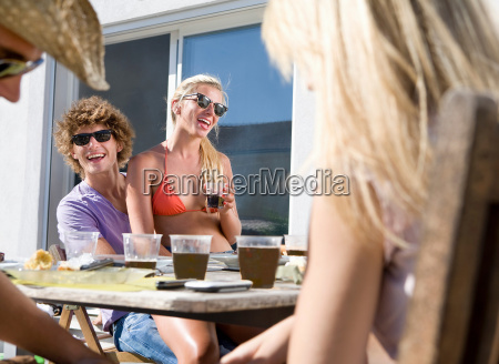 ple sit at picnic table with