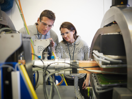 scientists working close up with particle