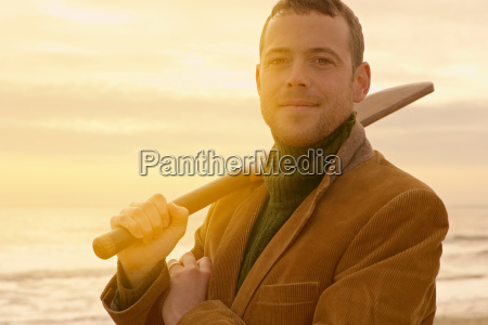 man on beach with old cricket