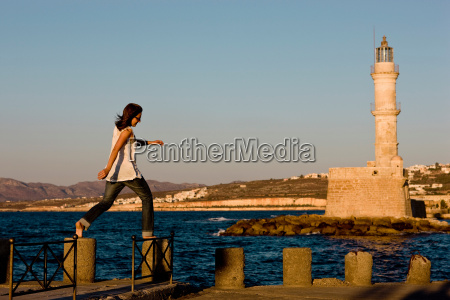 woman balancing on stones in front