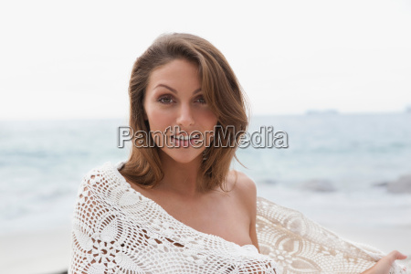 woman on beach wrapped in blanket