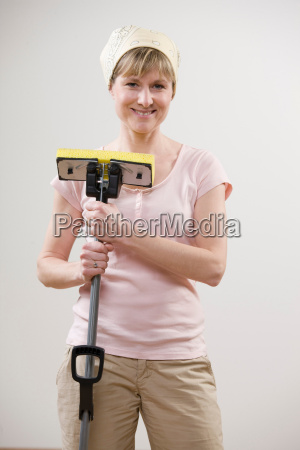 smiling woman holding mop
