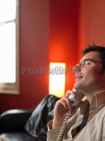 man talking on phone in living