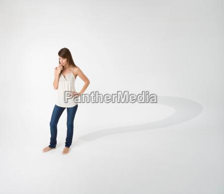 woman casting question mark shadow
