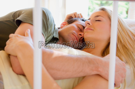 sleeping couple hugging in bed