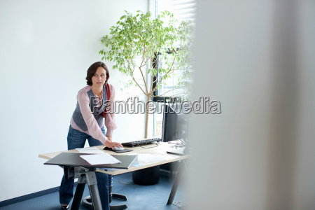 businesswoman using computer at desk