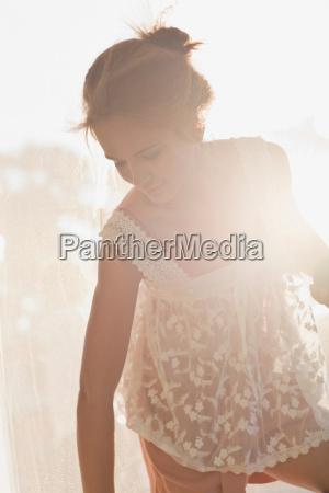 teenage girl wearing sheer dress