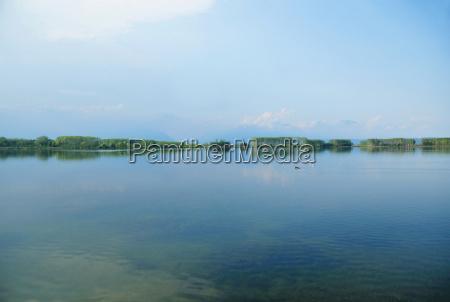 still lake under blue sky