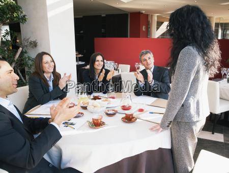 mature businesswoman receiving applause