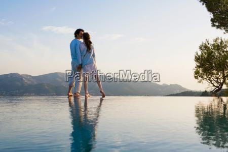 couple kissing and holding hands