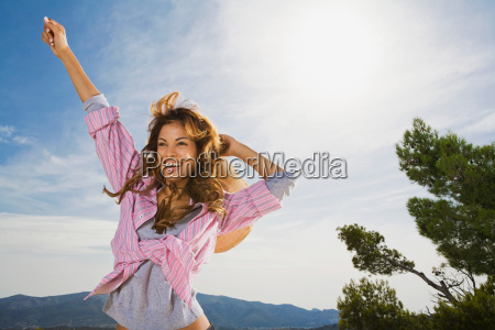 woman outdoors smiling