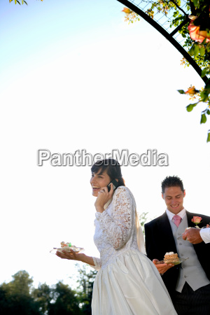 young bride using mobile phone