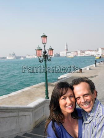 portrait of couple near lagoon