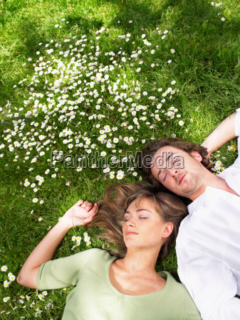 couple sleeping in the grass