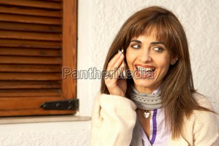 woman using mobile phone smiling