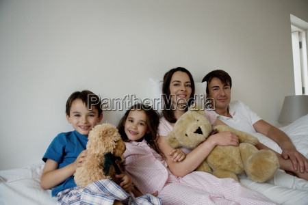 portrait of a family sitting on