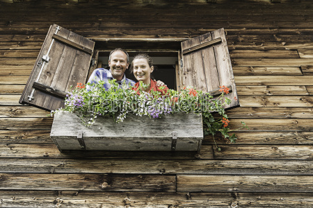 portrait of couple at chalet window