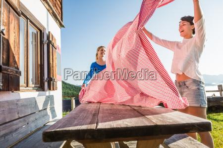 two women preparing table tyrol austria