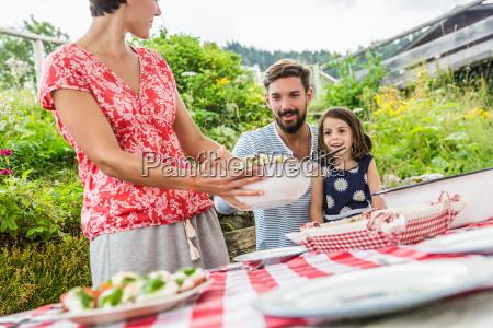 young family sharing picnic lunch tyrol