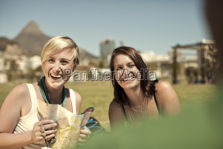 two young women with map cape