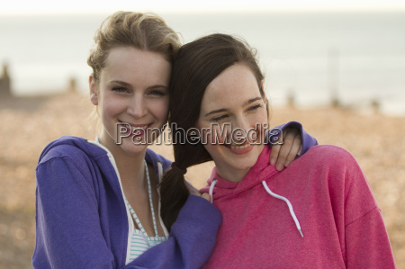 two young female friends on beach