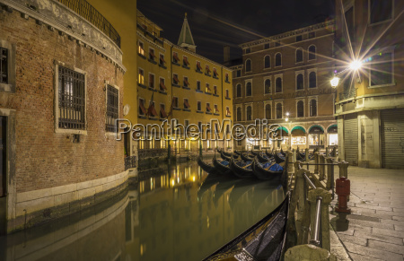 canal and gondolas at night venice