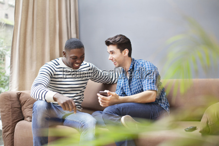 two young men with smartphone on