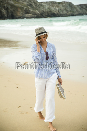 mature woman chatting on smartphone whilst
