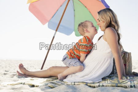 mid adult mother and son picnic