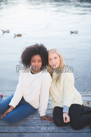 portrait of young female friends sitting