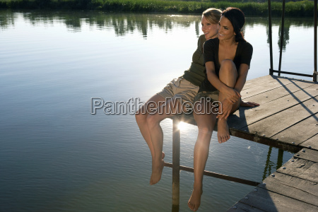 two young women on a pier