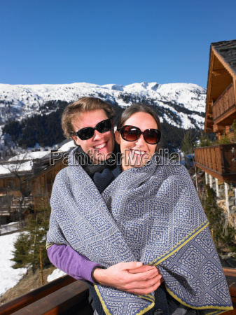 couple in blanket at mountains