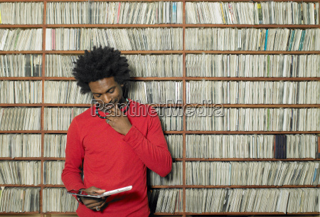 man looking at compact disc in