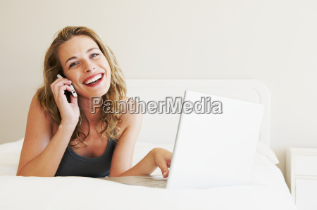 happy woman on phone lying on