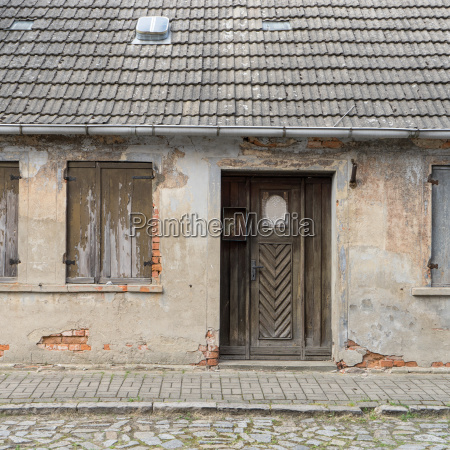 old dilapidated house with a wooden
