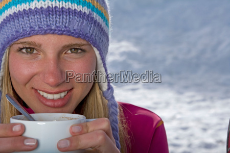 girl holding cup of tea
