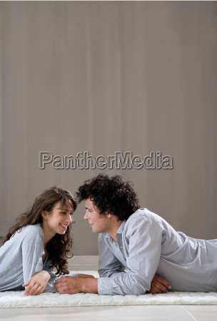 young couple laying on floor