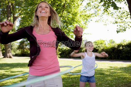mother and daughter with hula hoop