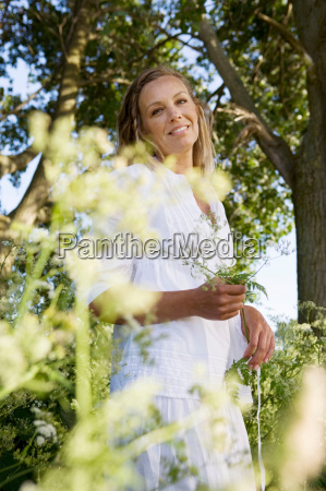 portrait of woman under trees