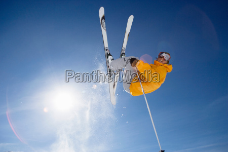 skier jumping shot from bellow