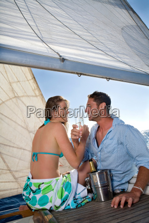 couple drinking champagne on sailboat