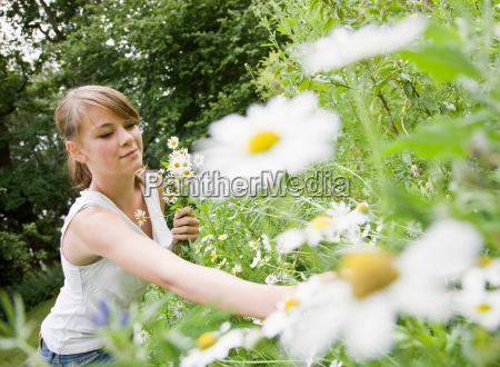 young girl picking flowers