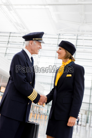 flight personnel shaking hands